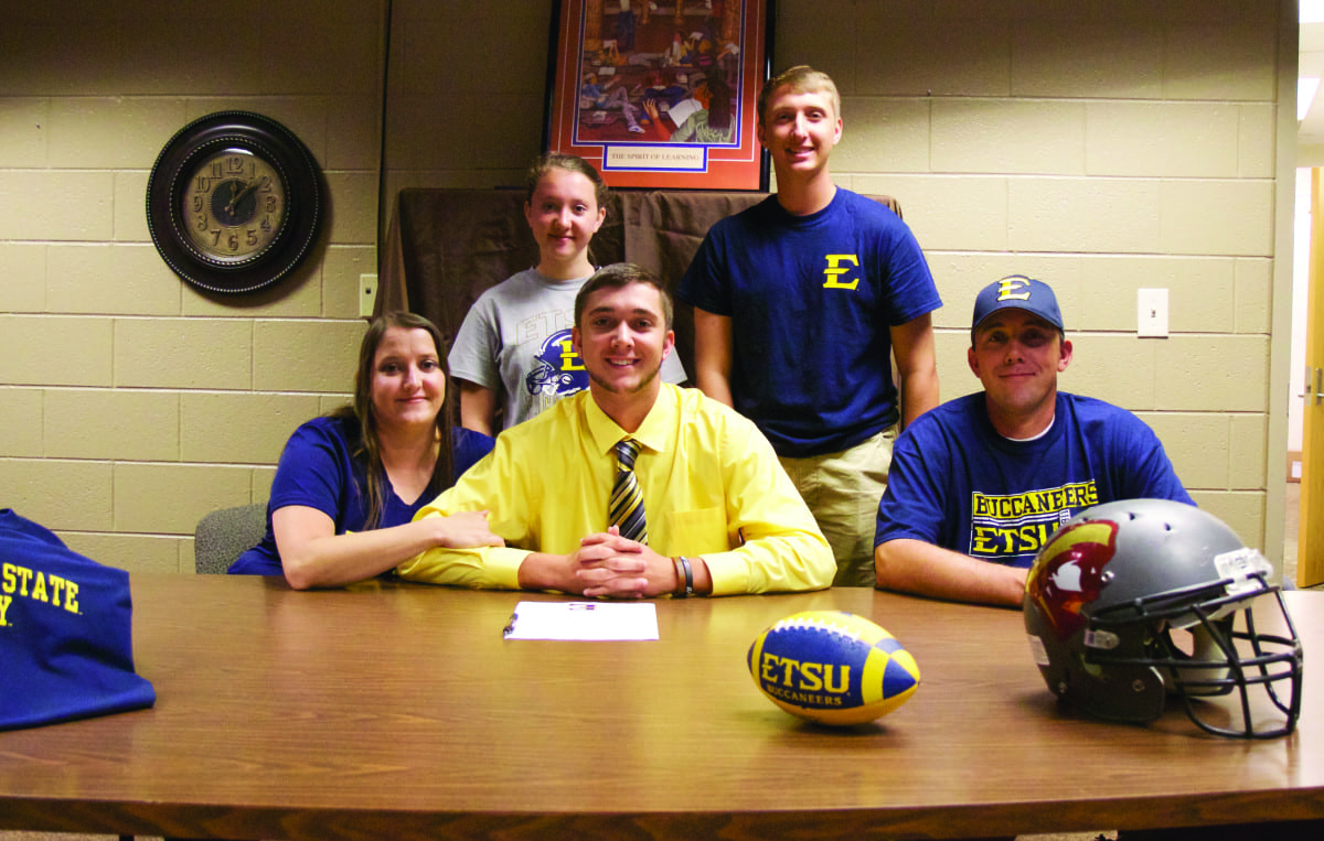 David Crockett's Ryan Burger (center) accepted a walk-on position with East Tennessee State University on Monday, May 2. He is joined in this photo by his mother, Latisha, left, and his father, Terry, right. Back row; left to right: sister, Aubri, and brother, Ethan.