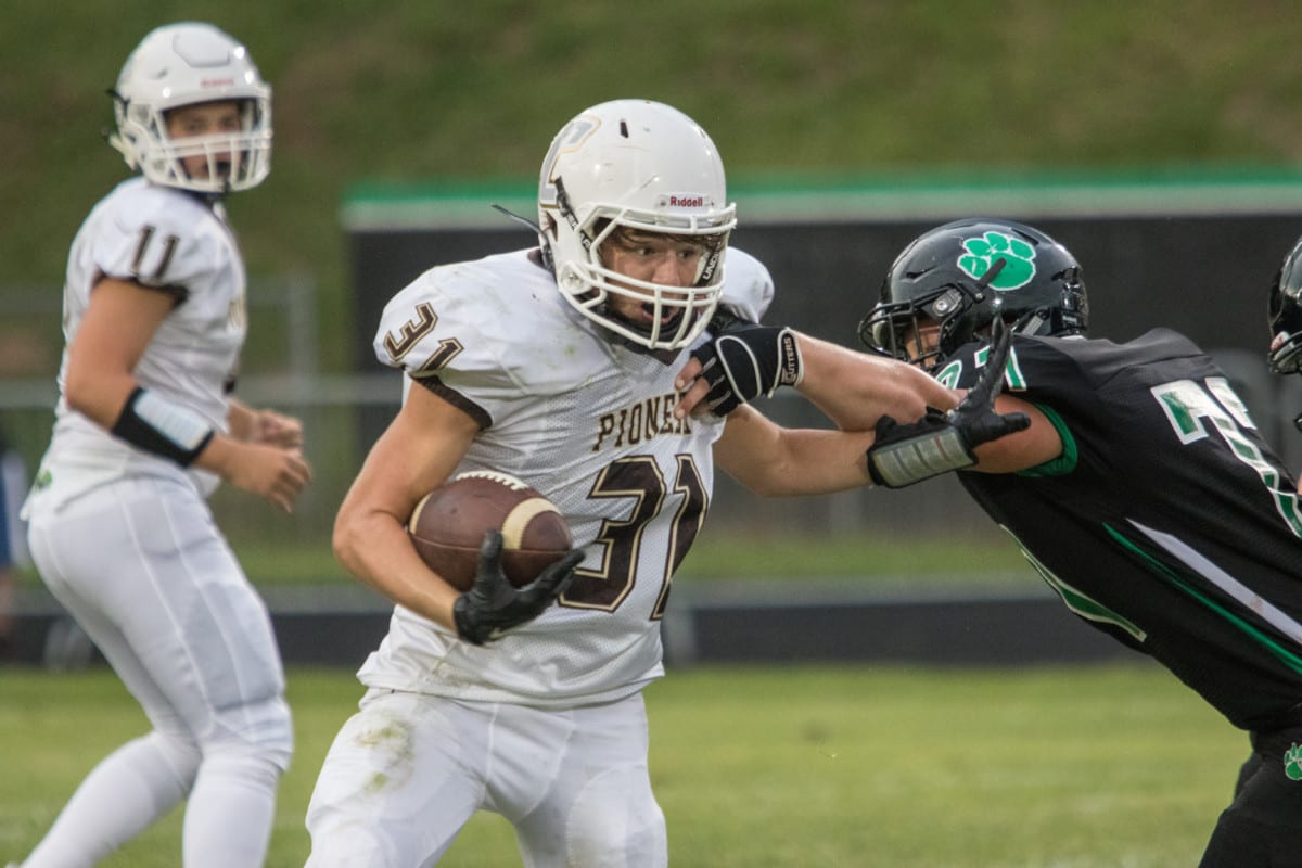 David Crockett's Zeb Holland pushes off a defender during the Pioneers contest at Mountain Heritage last Friday.