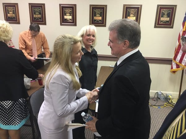 Kimber Halliburton, left, shakes the hand of current Washington County Director of Schools Ron Dykes. Halliburton was named the new Director of Schools for Washington County, which will take effect after Dykes retirement on July 30.