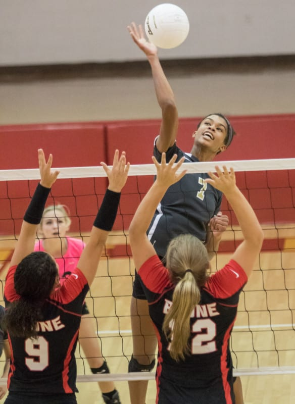 In this file photo, David Crockett's Addisyn Rowe goes above the net to try and deliver a kill.
