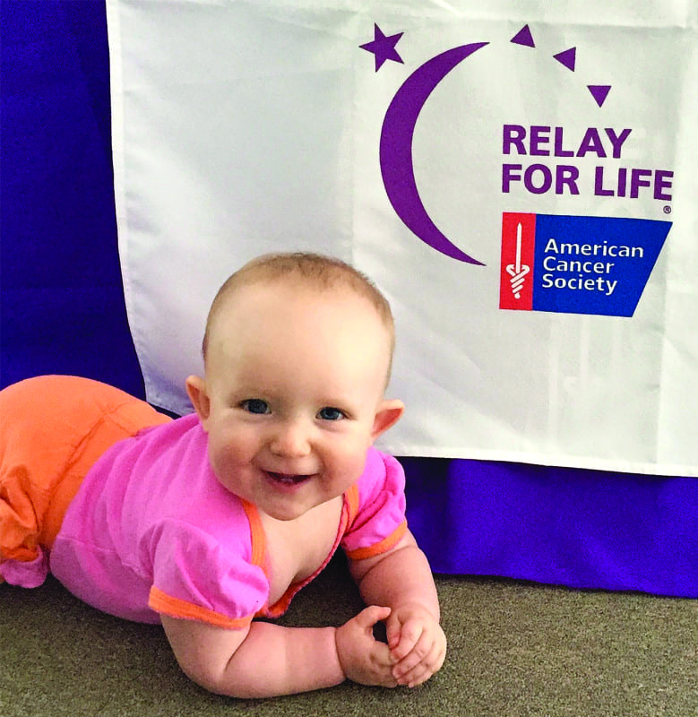 Jessica Poff's daughter Adellen is already showing her volunteer spirit with ACS.