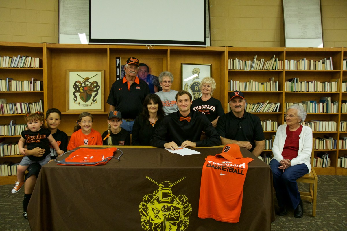 David Crockett senior Dustin Day, center, is surrounded by family members as he made his college decision official on Wednesday, May 4, to sign with Tusculum College.