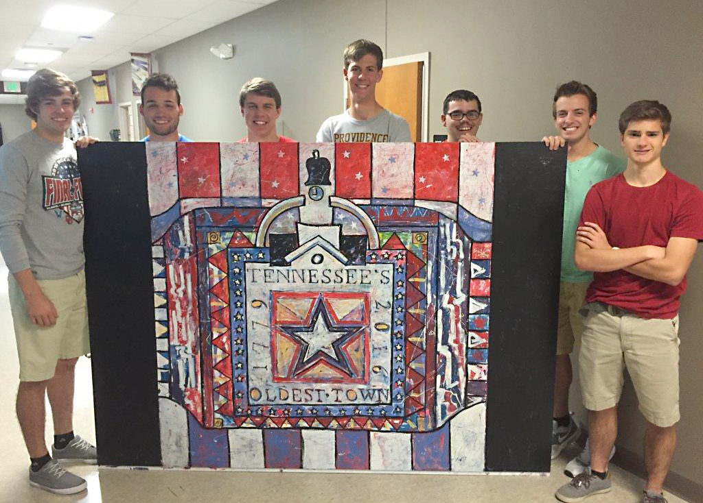 "The seniors from Providence Academy who worked on the murals, specifically the ""Fourth of July"" image. The boys names from left to right are Caleb Backus, Connor Smith, Jackson Graham, T.J. Koscak, Malachi Hayes, Trevor Trujillo, and Nathan Baccarossa."