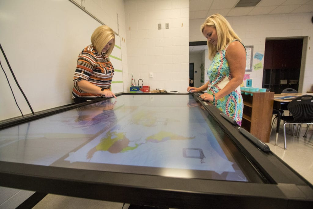 The 70-inch Cleartouch Interactive Panel has 10-point touch recognition. It also has the capability for the screen to be split into four smaller screens, which allows four activities to happen at once.