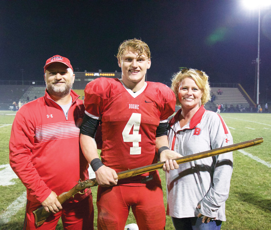 Charlie Cole, center, with his father, Charlie and mother, Sarah, after the Musket Bowl victory.
