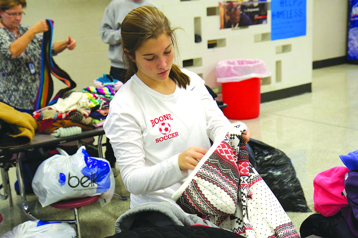 Lauren Wrigley joins her fellow Daniel Boone students in packing up supplies for area homeless and families in need.